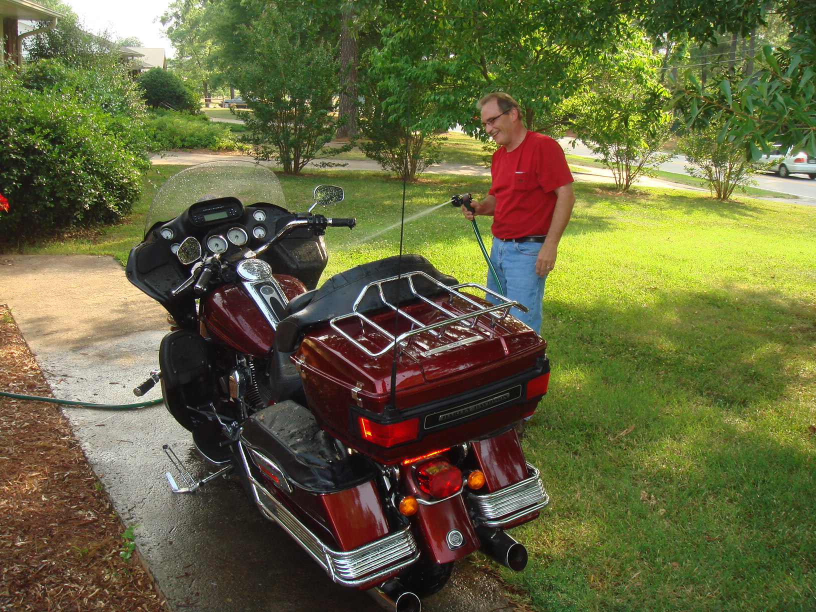 Terrie's husband Bobby washing Joni's bike?