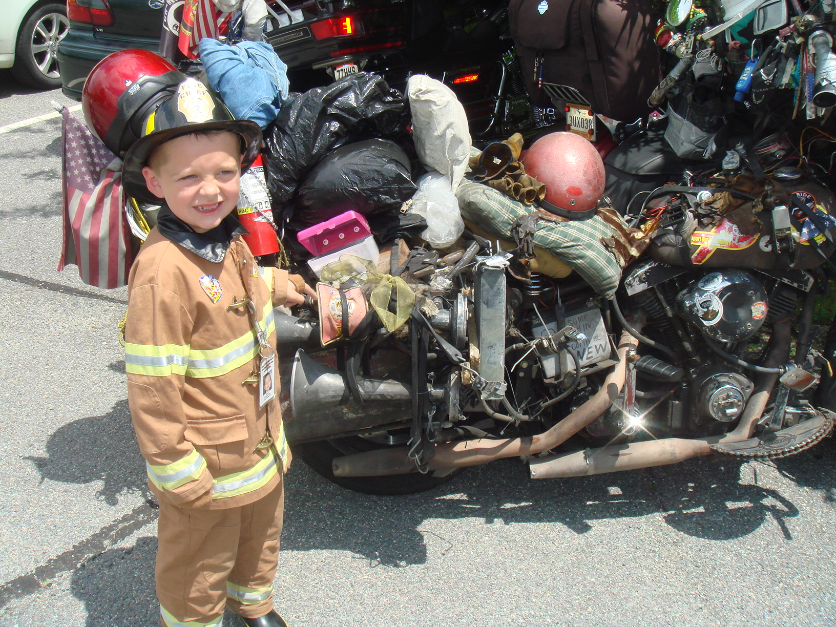 Brendeb pionting to the fire dept patch